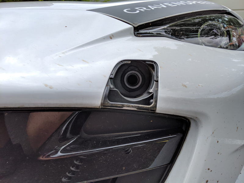 removing the towing eye cover