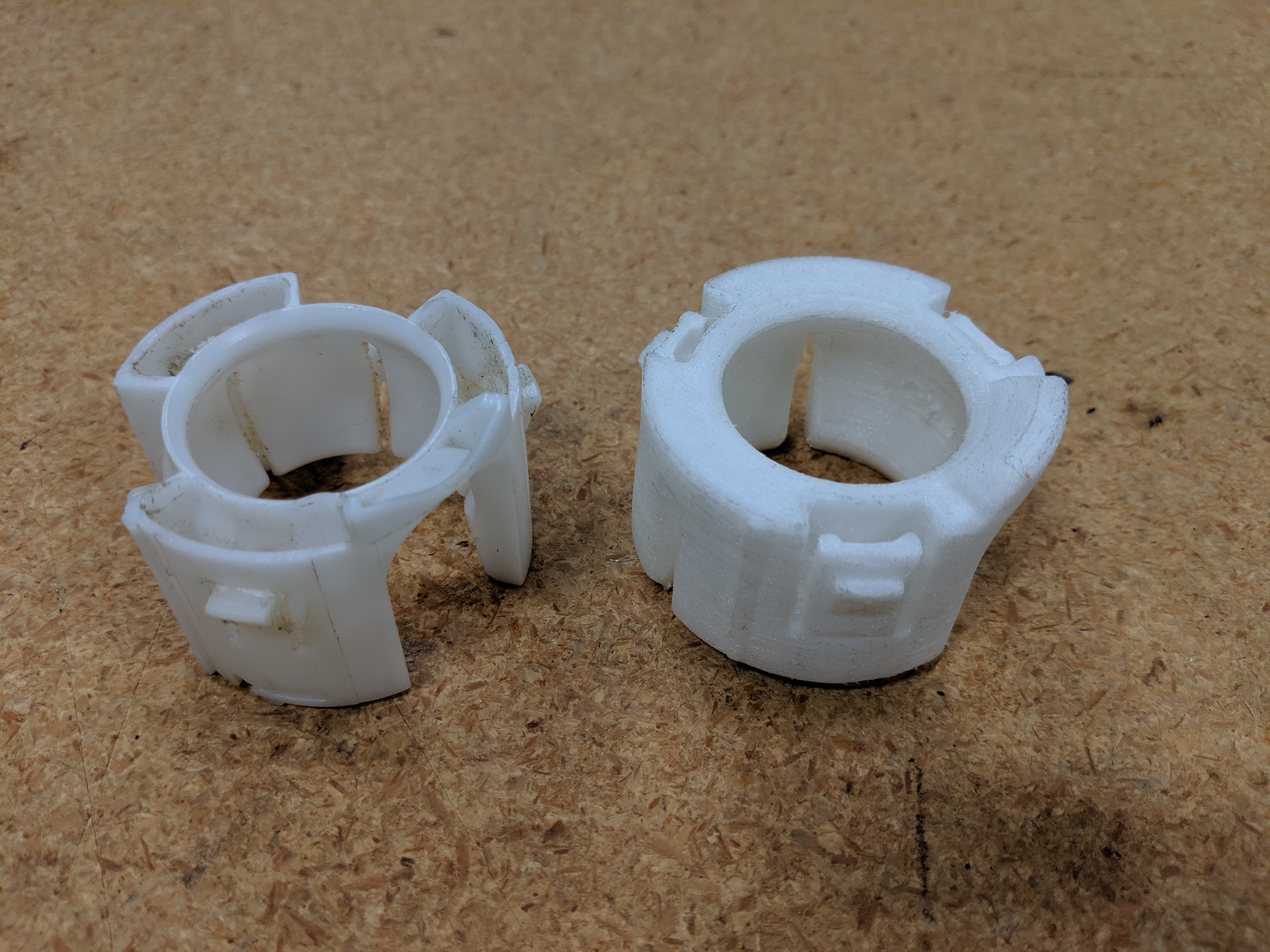 OEM and 3D printed clips side by side.