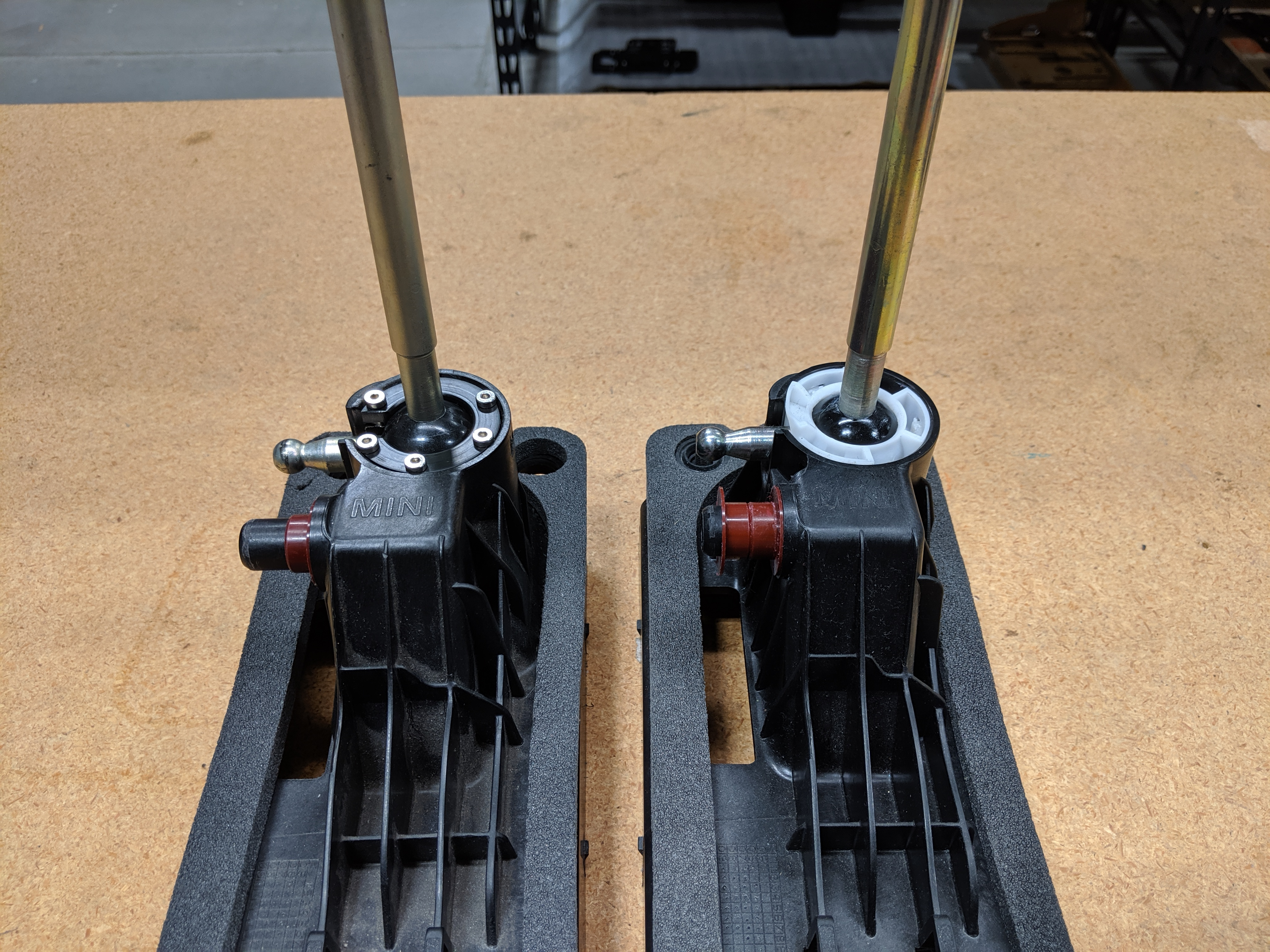 Housing with machined clip and OEM clip side by side.